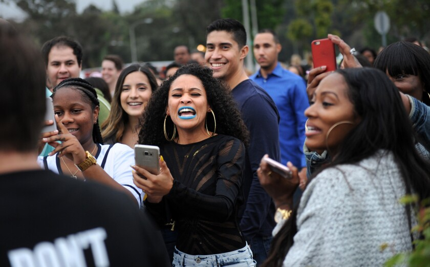 Fans take pictures outside the Rose Bowl before a Beyoncé concert Saturday.