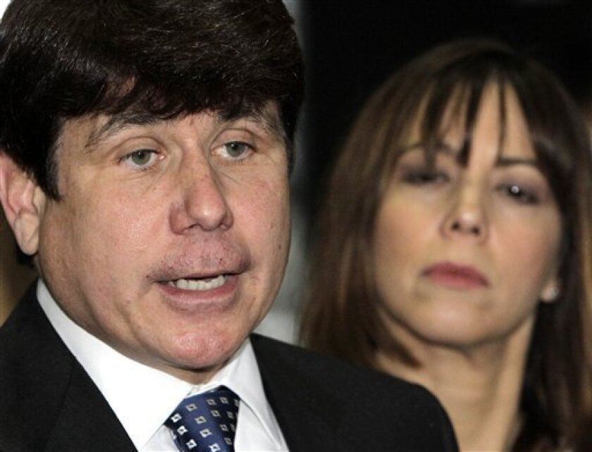 Former Illinois Gov. Rod Blagojevich, left, arrives at the Federal Court building with his wife Patti, for his federal corruption trial Tuesday, June 8, 2010 in Chicago. The jury is expected to be seated Tuesday morning with opening arguments to follow. (AP Photo/Charles Rex Arbogast)
