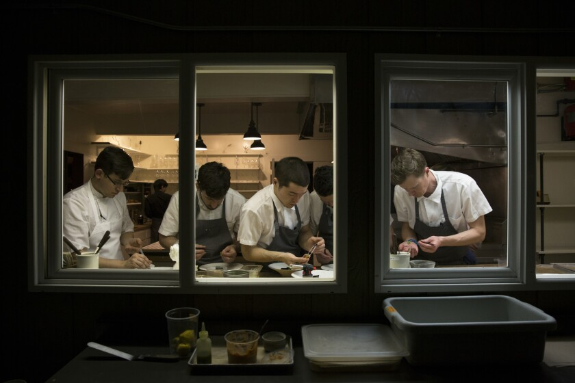 Chefs at work in the open kitchen at the Willows Inn.