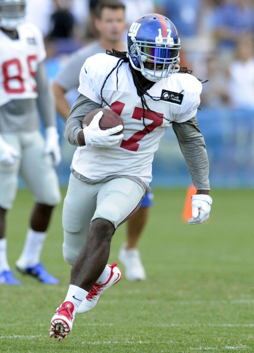 New York Giants wide receiver Dwayne Harris runs during an NFL football training camp Wednesday, Aug. 19, 2015, in East Rutherford, N.J. (AP Photo/Bill Kostroun)