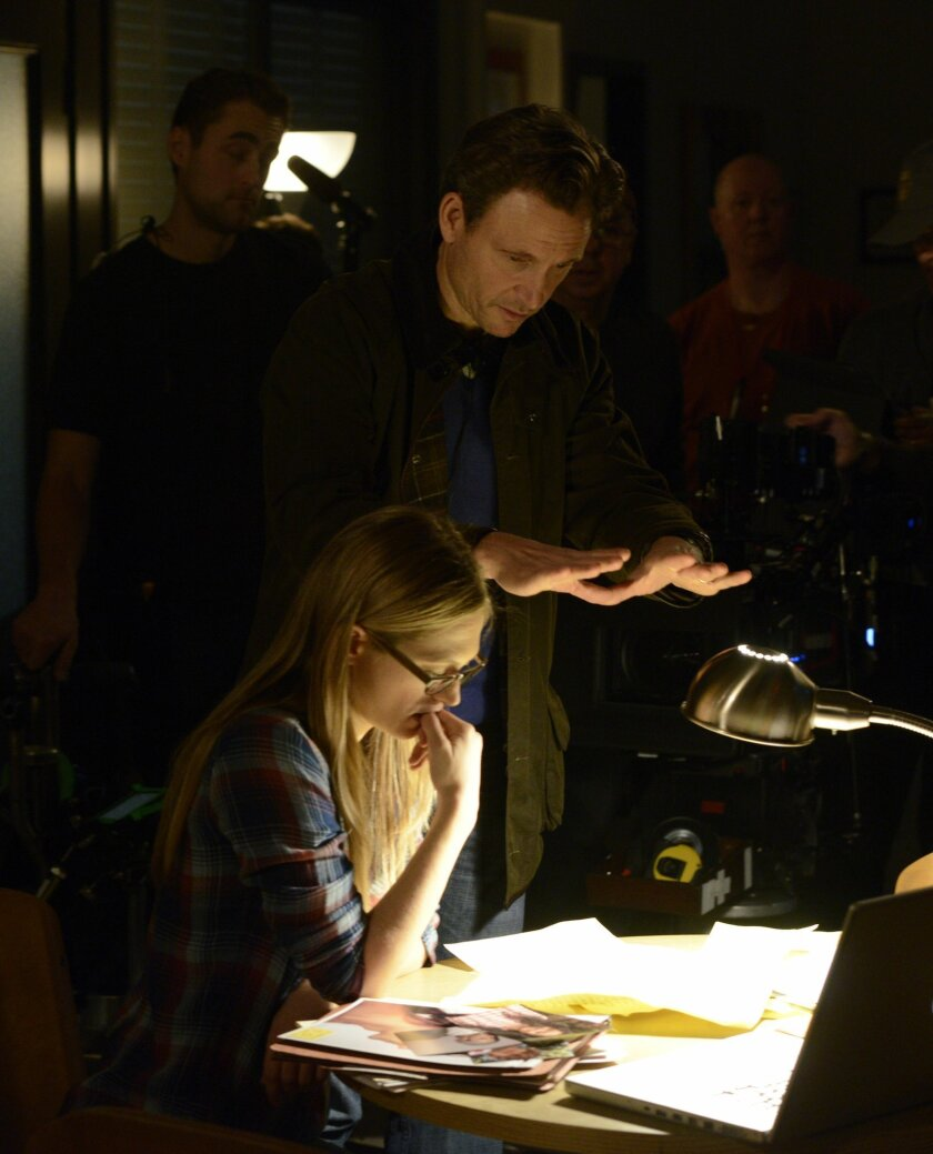 """This image released by WeTV shows director Tony Goldwyn with actress Marin Ireland on the set of """"The Divide."""" The series premieres Wednesday, July 16 at 9 p.m. ET. (AP Photo/WeTV)"""