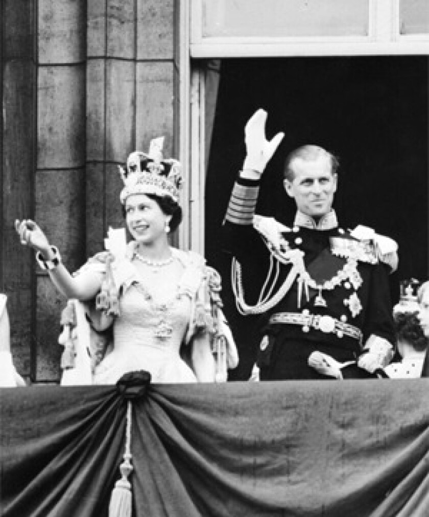 In a file picture taken on June 2, 1953 Britain's Queen Elizabeth II accompanied by Prince Philip waves to the crowd after being crowned during her coronation at Westminter Abbey in London.