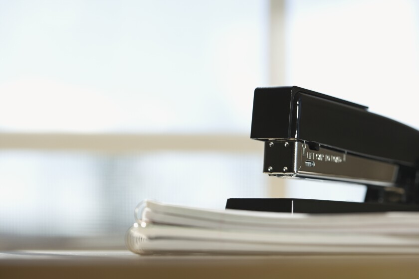 Black stapler on stack of paper with window in background. ** OUTS - ELSENT, FPG - OUTS * NM, PH, VA if sourced by CT, LA or MoD **