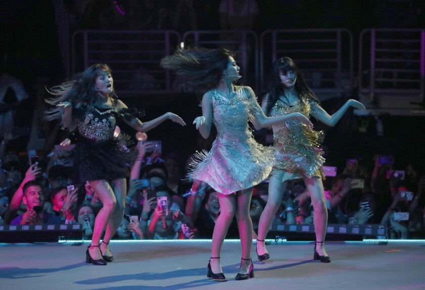 Twice performers Jihyo, left, Tzuyu and Momo on stage during a concert at KCON L.A. at Staples in 2018.