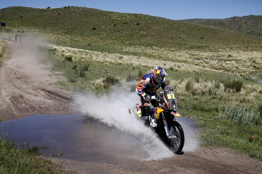Marc Coma, of Spain, rides his KTM motorcycle through a creek during the first stage of the Dakar Rally between the cities of Rosario and San Luis, Argentina, Sunday, Jan. 5, 2014. (AP Photo/Victor R. Caivano)