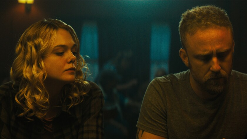 (L-R) Elle Fanning as Raquel Arceneaux and Ben Foster as Roy Cady in the thriller, drama film ?GALVE