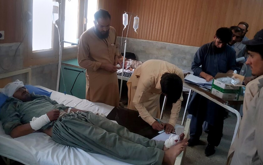 A victim in a bus accident is treated at a hospital in Chilas, northwest Pakistan, Sunday, Sept. 22, 2019. Pakistani police say a bus has rammed into a hill after it breaks failed on a mountainous road, killing some passengers and injuring more than a dozen in the country's northwest. (AP Photo/Muhammad Qasim)