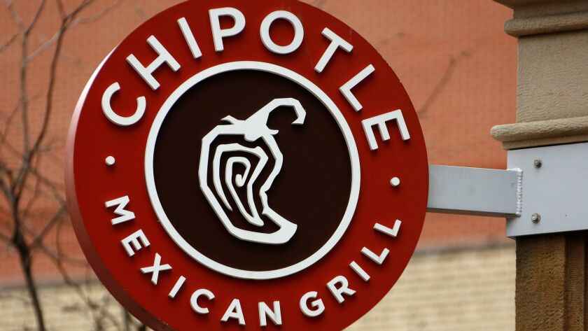 FILE- This Jan. 12, 2017, file photo shows the sign on a Chipotle restaurant in Pittsburgh. Chipotl