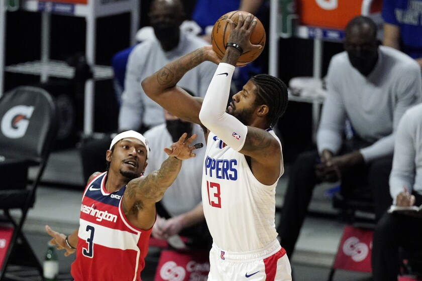 Clippers guard Paul George shoots over Washington Wizards guard Bradley Beal