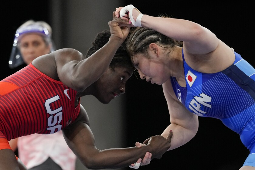 FILE - In this Aug. 2, 2021, file photo, United States' Tamyra Marianna Stock Mensah, left, and Japan's Sara Dosho compete during the women's 68kg freestyle wrestling match at the 2020 Summer Olympics in Chiba, Japan. Tokyo Olympians are exercising extraordinary discipline against the coronavirus. They are sealed off in a sanitary bubble that has made competition possible but is also squeezing a lot of fun from their Olympic experience. (AP Photo/Aaron Favila, File)
