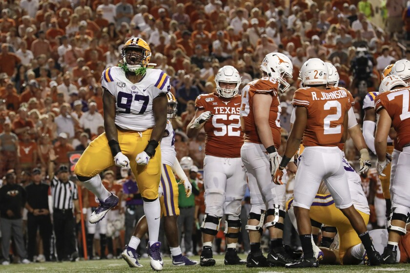 LSU's Glen Logan celebrates after a sack in the fourth quarter against Texas on Saturday in Austin, Texas.