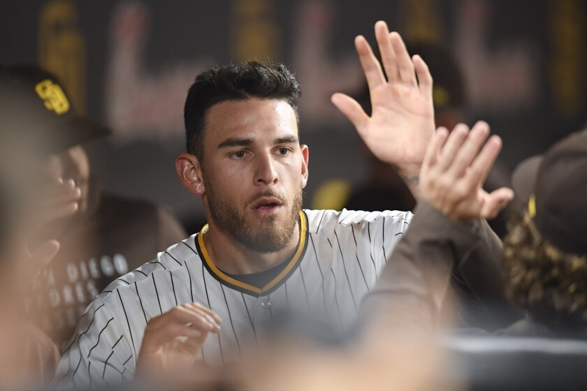 The Padres' Joe Musgrove is congratulated in the dugout