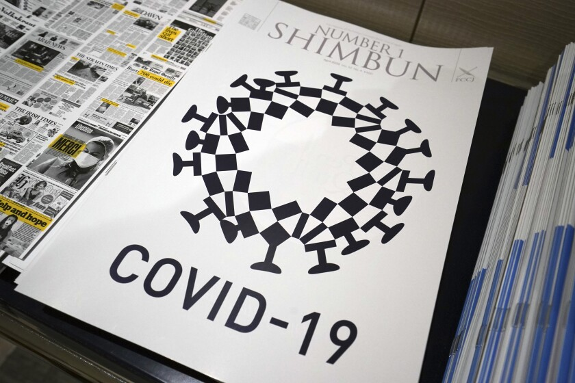 A cover design for the magazine Number 1 Shimbun combined the Tokyo 2020 logo with features of the COVID-19 virus.