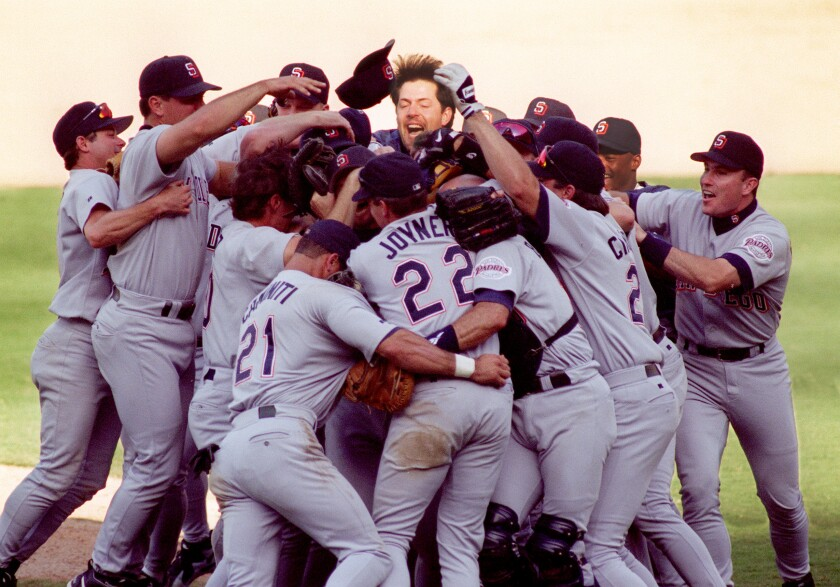 Padres players celebrate after their 11-inning, 2-0 victory over the Dodgers for the NL West championship in 1996.