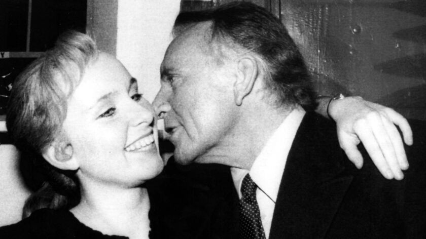 Kate Burton, co-star of the Broadway show, Doonesbury, gets a kiss from her dad, Richard Burton, af