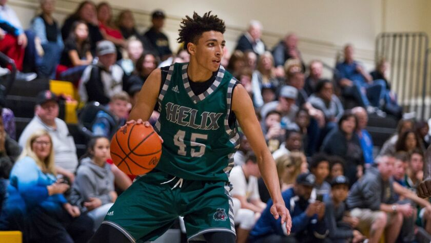 Helix's Miles Norris looks to pass against El Capitan.