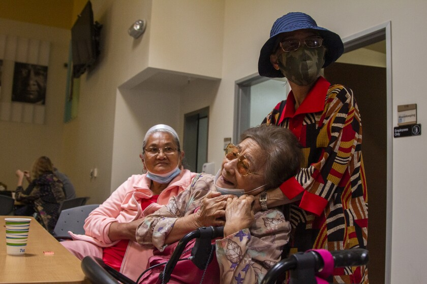 Carmencita Hyles watches her friend Primitiva Antonio reunite with Elena Batesting at the Gary and Mary West center