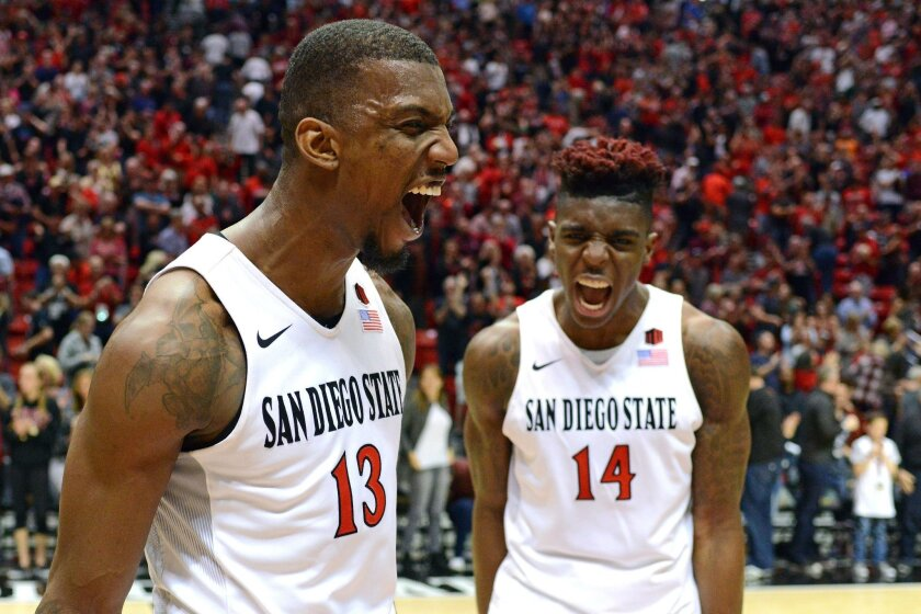 Feb 6, 2016; San Diego, CA, USA; San Diego State Aztecs forward Winston Shepard (13) and forward Zylan Cheatham (14) celebrate after a 78-71 overtime win over New Mexico Lobos at Viejas Arena at Aztec Bowl. Mandatory Credit: Jake Roth-USA TODAY Sports ** Usable by SD ONLY **