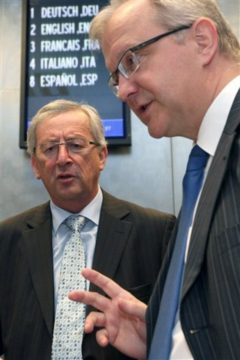 Luxembourg's Prime Minister and President of the Eurogroup Jean Claude Juncker, left, talks with EU Commissioner for Economic Affairs Olli Rehn at the start of a Eurogroup meeting in Luxembourg, Monday, June 7, 2010. (AP Photo/Geert Vanden Wijngaert)