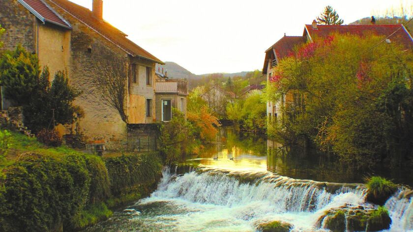 There are few places in Arbois where you cannot hear the flow of the Cuisance River as it winds its