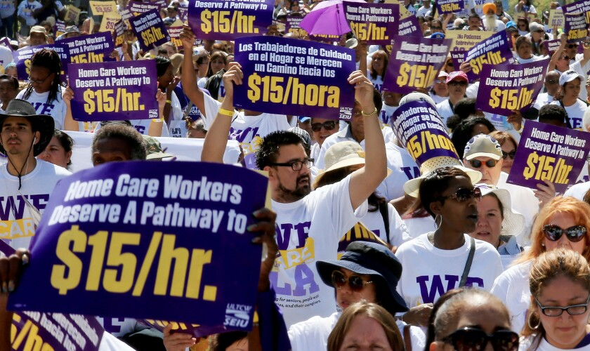 L.A. County homecare workers march downtown to call for a hike in the minimum wage to $15 per hour on April 14, 2015. Los Angeles County supervisors voted to create a new wage enforcement program to police violations of the county's minimum wage law.