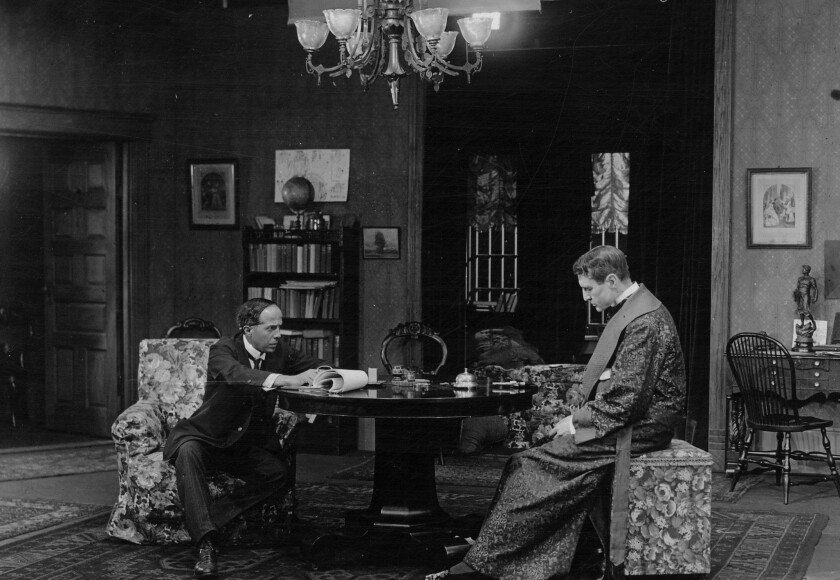 "Director Arthur Berthelet, left, and actor William Gillette on the set of 1916's ""Sherlock Holmes."""