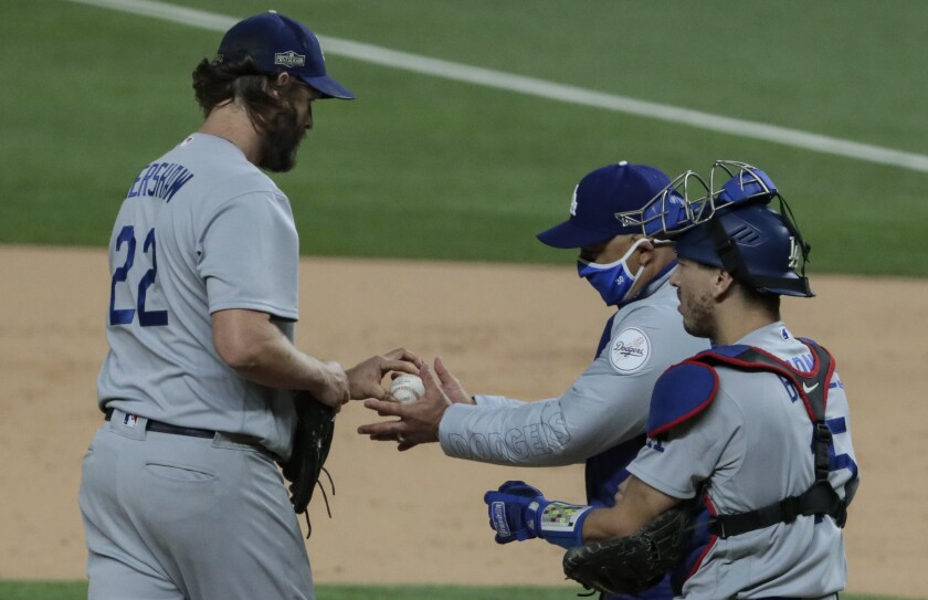 Dodgers manager Dave Roberts takes the ball from pitcher Clayton Kershaw.