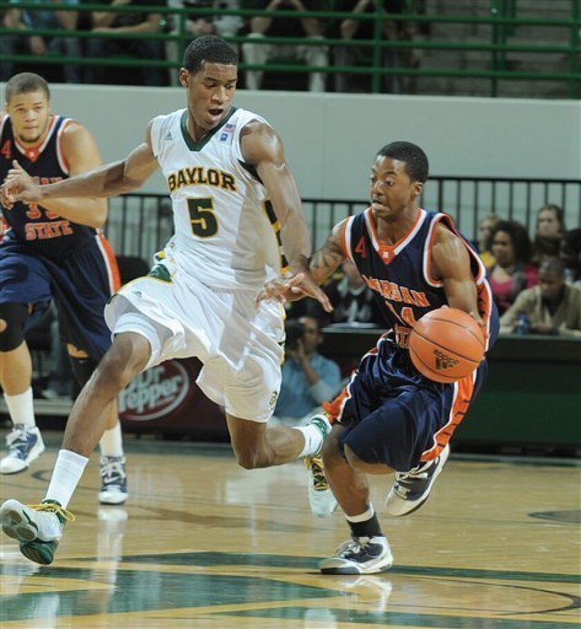 Morgan State's Derrick Banks, right, is pressured by Baylor's Perry Jones III, left, in the first half of an NCAA college basketball game, Tuesday, Jan. 4, 2011, in Waco, Texas. (AP Photo/Waco Tribune Herald)