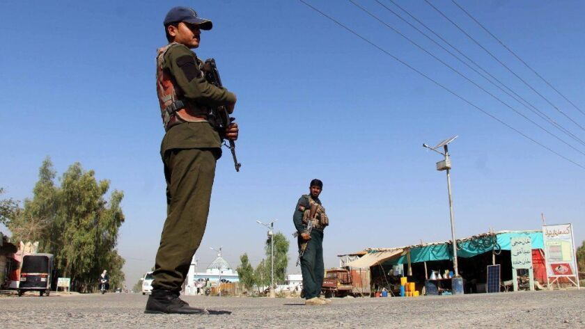 Afghan security personnel guard a checkpoint in Kandahar, Afghanistan.