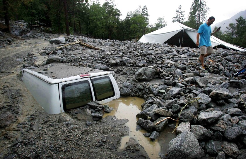 Van buried in mud and rocks after thunderstorm