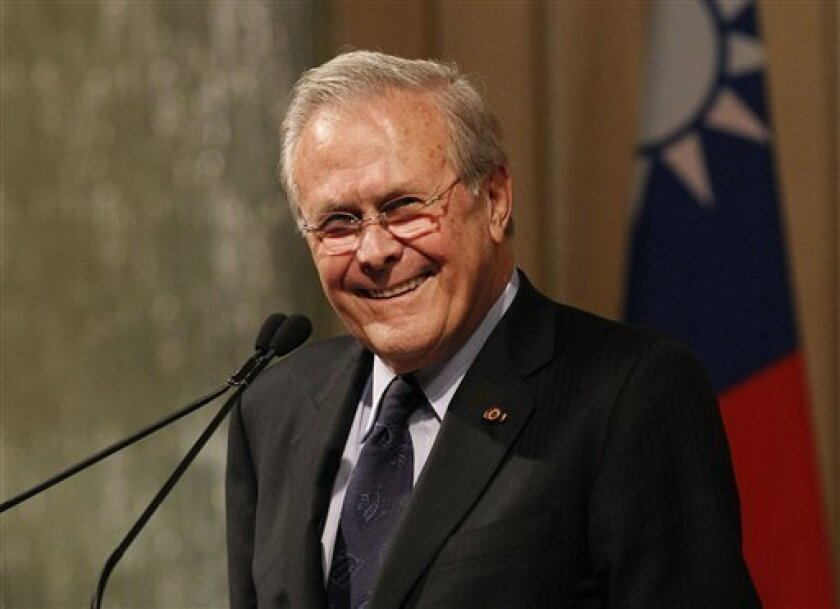 FILE - This Oct. 11, 2011 file photo shows former U.S. Secretary of Defense Donald Rumsfeld speaking during a luncheon on security in rising Asia, in Taipei, Taiwan. (AP Photo/Wally Santana, file)