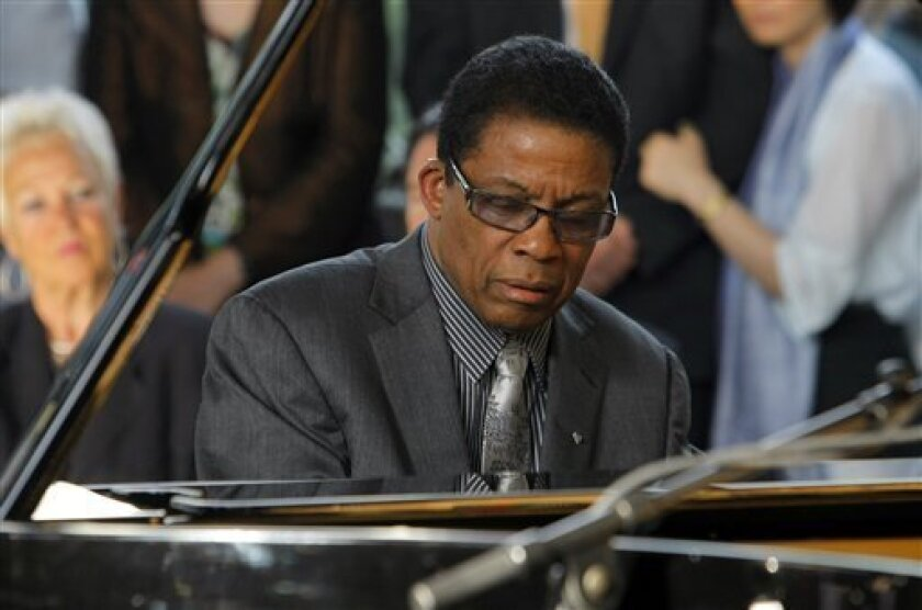 Keyboard icon Herbie Hancock, the first jazz artist to ever have a hit video on MTV and the United Nation's newest UNESCO Goodwill Ambassador, performs with his multinational quartet Sept. 23 at San Diego's Balboa Theater. (AP Photo/Jacques Brinon)