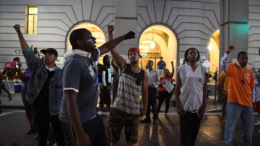 Protesters supporting the Black Lives Matter movement chant outside Los Angeles City Hall on July 14.