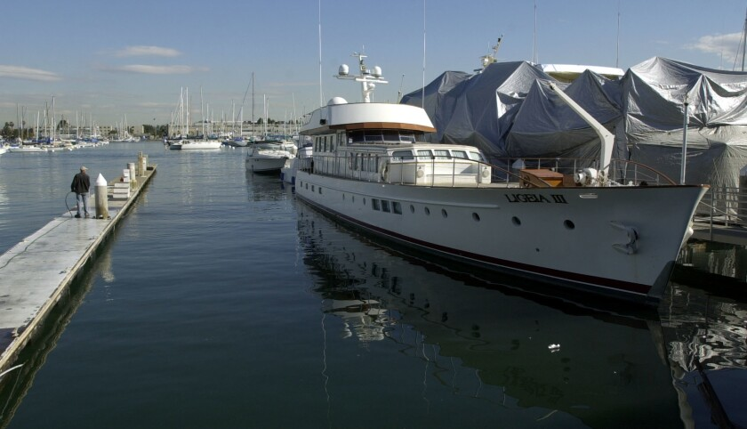 """The motor yacht Ligeia III moored at Nielsen Beaumont Marine on Shelter Island was seized by federal marshals in 2003 as part of restitution owed by Vladislav """"Steven"""" Zubkis."""