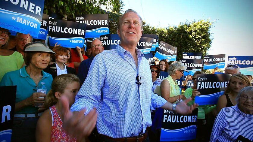 Surrounded by family and supporters, mayoral candidate and San Diego City Council member Kevin Faulconer welcomes everyone to the grand opening of his campaign headquarters last month.