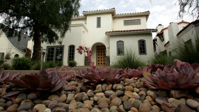 Water-saving features at a home in Santa Monica include drought-tolerant plants that help hold water in the yard.