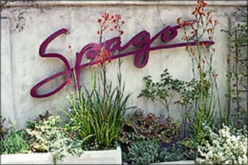 The Better Business Bureau's Los Angeles chapter gave Wolfgang Puck's Spago restaurant, which declined to pay the bureau's subscription fees, a grade of B-minus, while less prominent restaurants that paid the subscription fees received higher ratings.