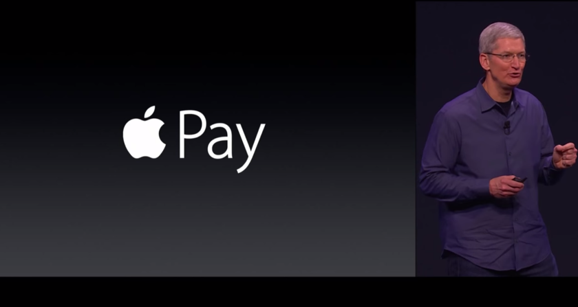 Apple CEO Time Cook introduces Apple Pay as a uniquely secure payment processing system at a corporate event in September 2014.