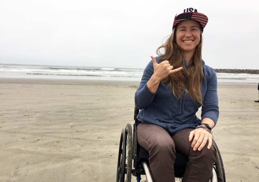 Adaptive surfer Sarah Bettencourt, 35, of Rancho Penasquitos at USA Surfing's 2019 Adaptive Surfing Championship Thursday at Oceanside Harbor's North Jetty beach.