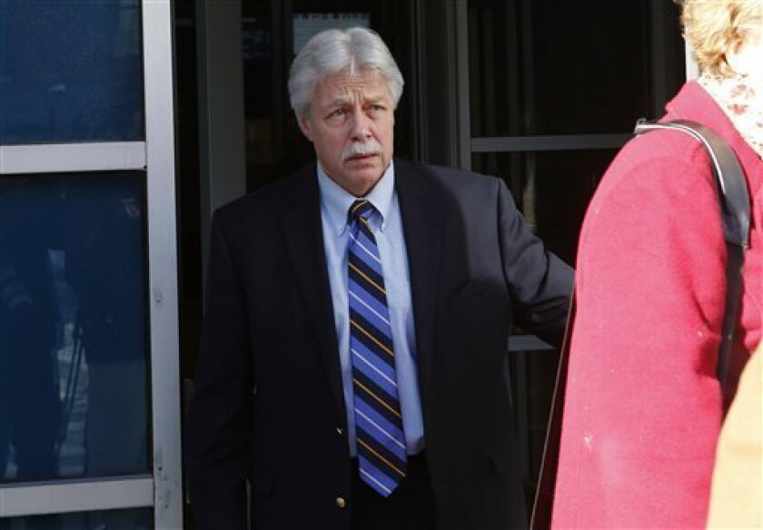 FILE - In this Jan. 18, 2013 file photo, Mark Strong Sr., leaves the Cumberland County Court House in Portland, Maine. The jury in Strong's trial watched a video Thursday, Feb. 28, 2013, showing a sexual encounter between Zumba fitness instructor Alexis Wright and a man who left cash on her massage table. Strong is charged with 13 counts that relate to promoting prostitution. He contends he had an affair with Wright and helped her launch her Pura Vida dance studio in Kennebunk, Maine, but his