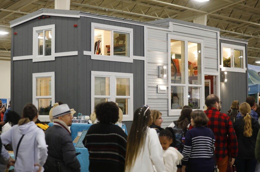 People wait in line to go into an 367 square-foot home made by Tiny Mountain Homes at TinyFest at the Del Mar Fairgrounds on March 1, 2020. The two-day festival had a variety of tiny houses from pro-builders, DIYers, van lifers and tiny dwellers.