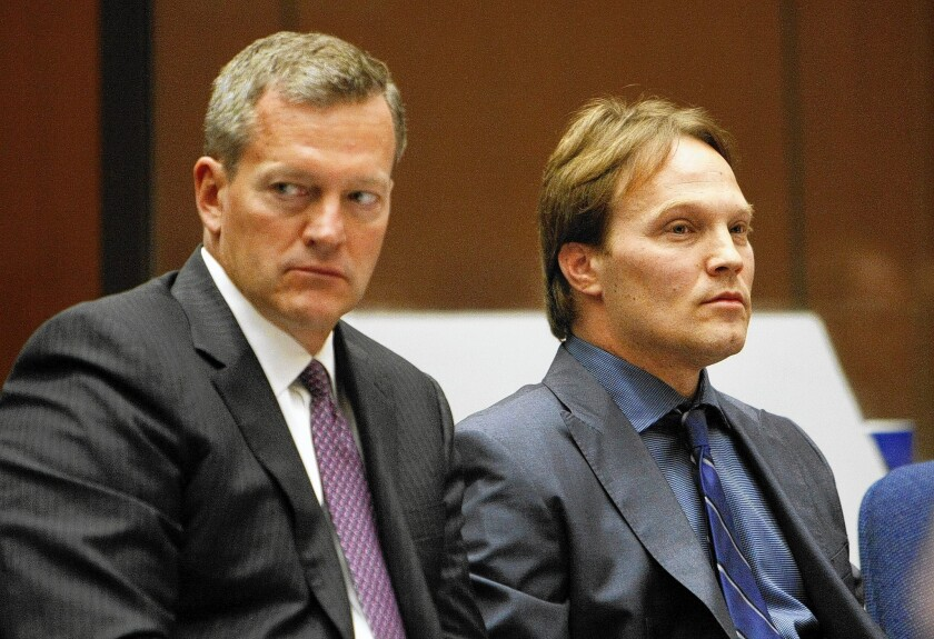 UCLA chemistry professor Patrick Harran, right, sits with his attorney, Thomas O'Brien, after he struck a deal with prosecutors that all but frees him from criminal liability in a 2008 laboratory fire that killed a staff research assistant.