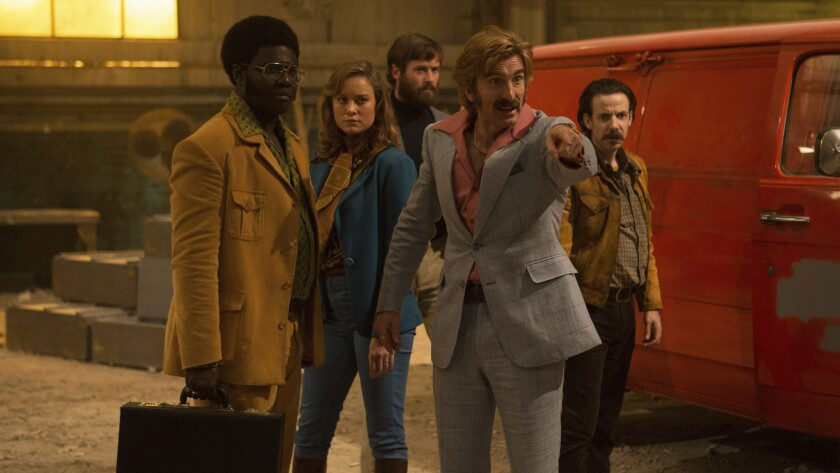 """Sharlto Copley, pointing, in the shoot 'em up """"Free Fire,"""" with from left, Babou Ceesay, Brie Larson"""