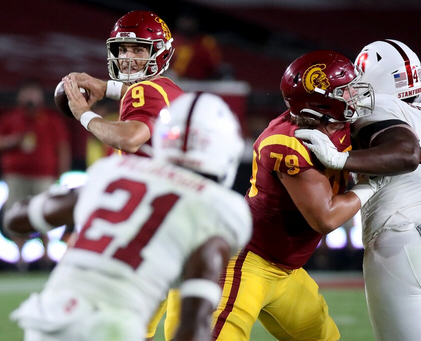 USC quarterback Kedon Slovis looks to throw downfield.