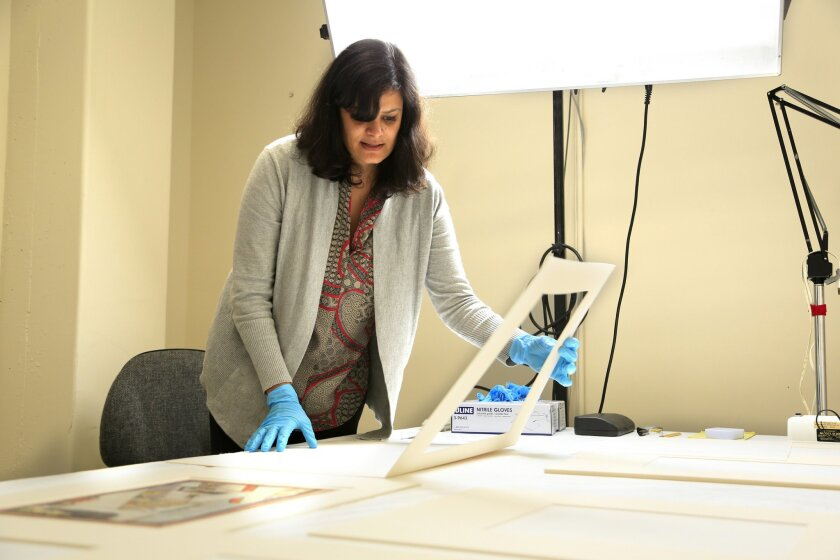 Curator Marika Sardar considers which works from the Binney Collection should be put on display. Photo: James Gregg