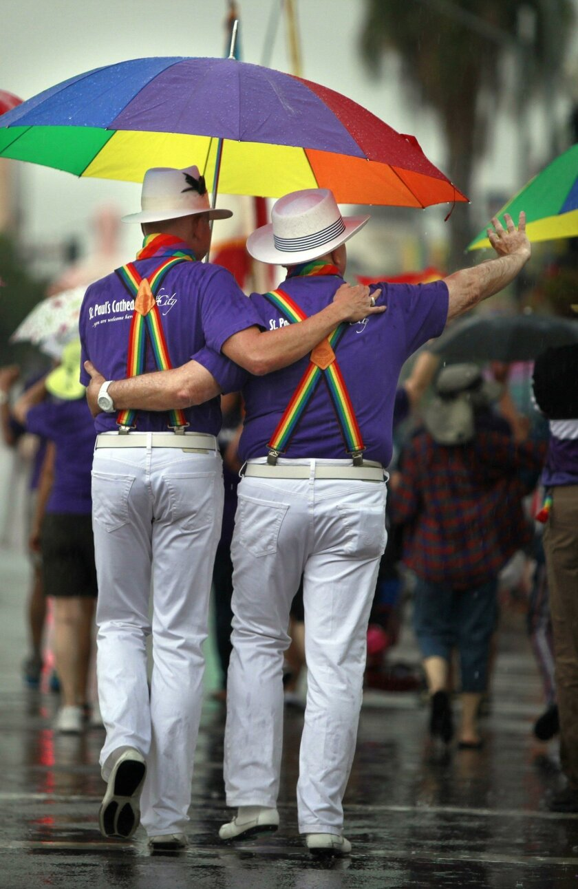 Mike Curtin and Dr. Carl Jepsen walk in the San Diego LGBT Pride Parade. This year's parade begins at 11 a.m. Saturday.