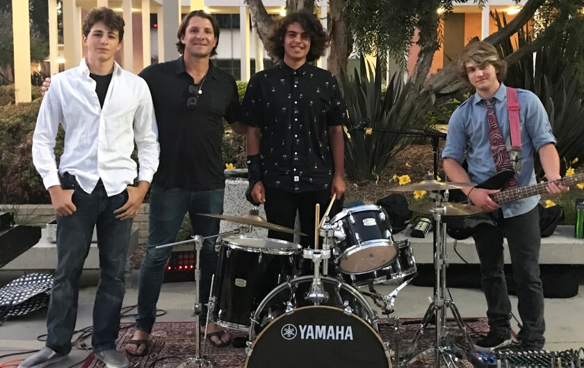 Indie rock band The Elements with 5-time Olympian Tony Azevedo at The Aquatic Games June 29, 2018 at California State University, Long Beach. This year, The Elements will kick off off the Opening Ceremonies June 21 at California State University, Long Beach. From Left: Eli Anderson, Tony Azevedo, Dylan Herrera and Julian Boyer.