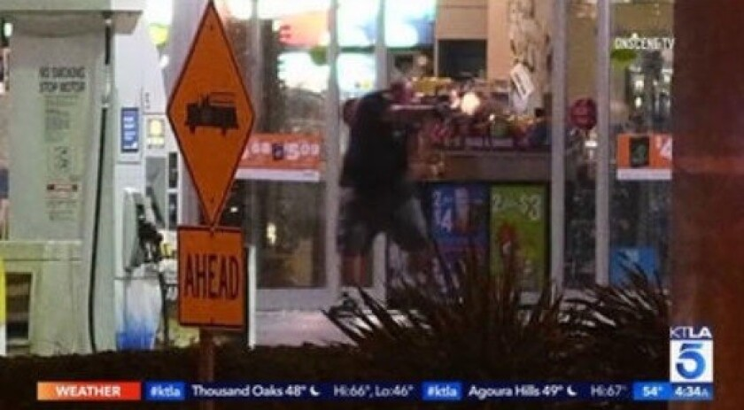 An attempted robbery suspect is shot and killed by Los Angeles County Sheriff's deputies in La Mirada.