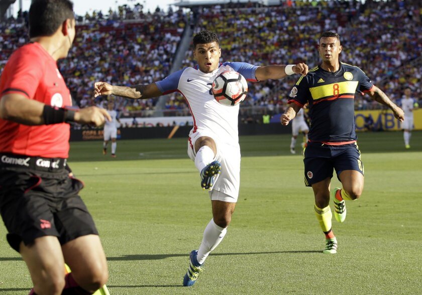 DeAndre Yedlin of the United States, controls the ball next to Colombia's Edwin Cardona during a Copa America Centenario Group A soccer match at Levi's Stadium in Santa Clara, Calif., Friday, June 3, 2016. (AP Photo/Marcio Jose Sanchez)