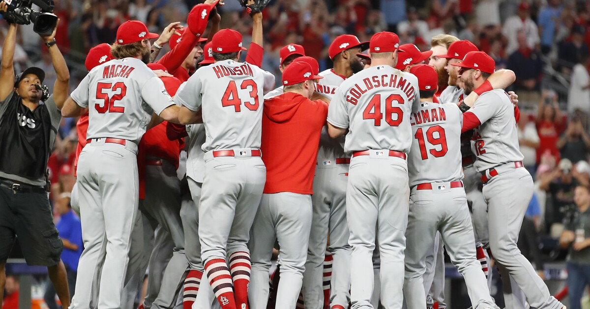 Cardinals pour it on early to dominate the Braves in Game 5 of an NLDS